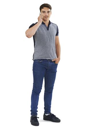 full shot: Studio Portrait Of Teenage Boy Talking On Mobile Phone