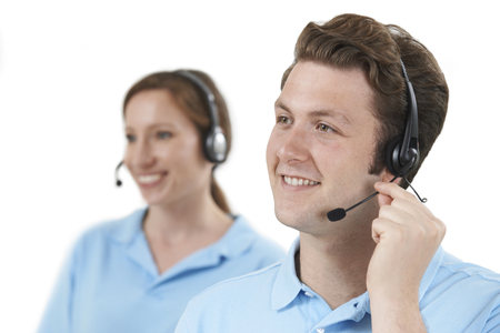 white men: Staff Answering Calls In Customer Service Department Stock Photo