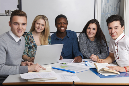 secondary schools: Group Of Teenage Students Working In Classroom Stock Photo