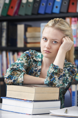 fed up: Fed Up Teenage Student In Library