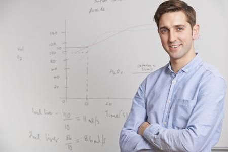 teachers: Portrait Of Teacher Standing In Front Of Whitebaord