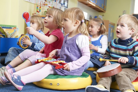 lesson: Group Of Pre School Children Taking Part In Music Lesson