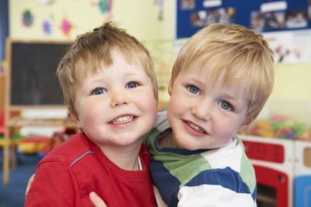pre school: Two Boys Hugging One Another At Pre School