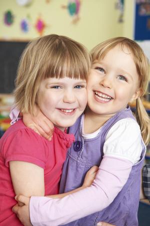 two girls hugging: Two Girls Hugging At Pre School