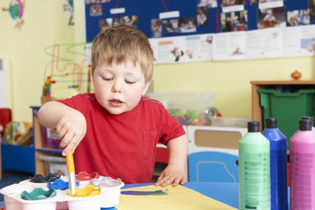 pre school: Male Pre School Pupil In Art Lesson Stock Photo