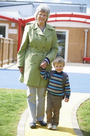 grandmother and grandson: Grandmother Taking Grandson To School