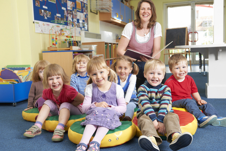 pre school: Class Of Pre School Children At Story Time With Teacher