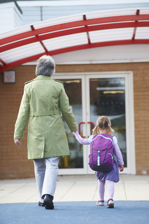 view girl: Grandmother Taking Granddaughter To School