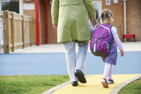 first day of school: Parent Taking Child To Pre School Stock Photo