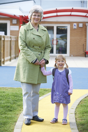 first day: Grandmother Taking Granddaughter To School