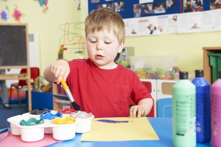 pre school: Pre School Boy Enjoying Painting Class