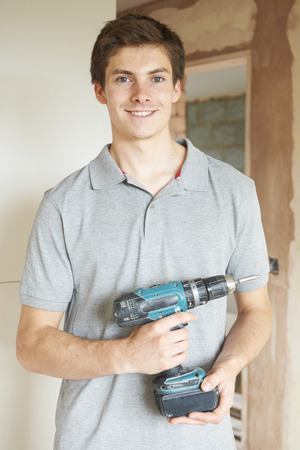 power tool: Builder Using Power Tool On Site