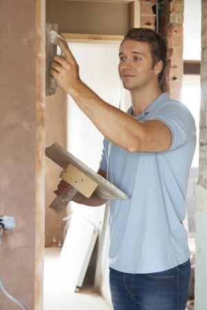 plasterer: Plasterer Working On Wall