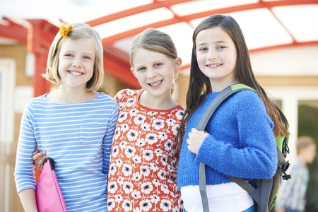 book bags: Group Of Girls Standing Outside School With Book Bags