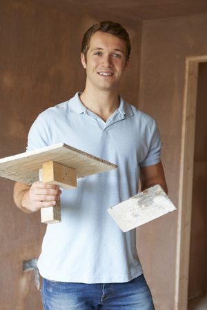 man at work: Plaster Working In Finished Room Stock Photo