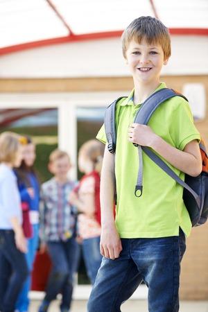 rucksack ': Boy Standing Outside School With Rucksack