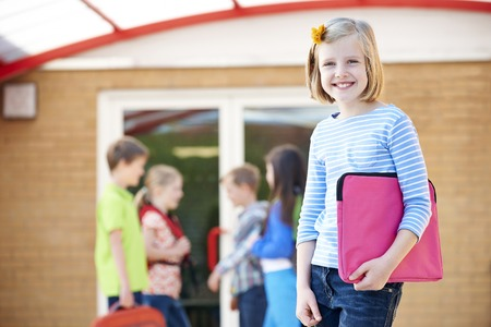 book bag: Girl Standing Outside School With Book Bag