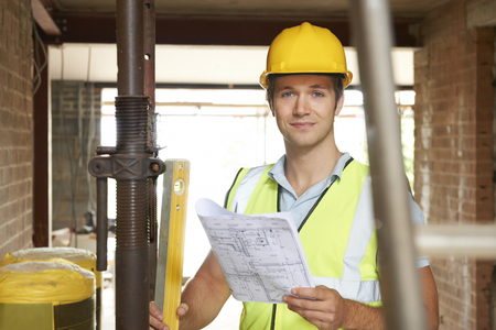 home builder: Portrait Of Builder On Site With Plans