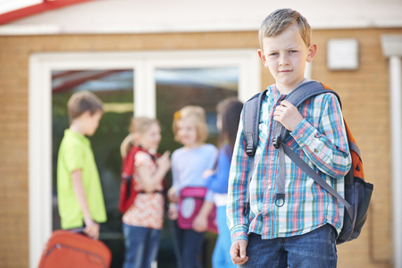 standing together: Boy Standing Outside School With Rucksack