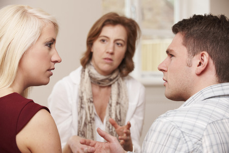 relationship problems: Couple Talking To Relationship Counsellor Stock Photo
