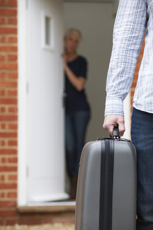 unrecognisable person: Man With Packed Suitcase Leaving Wife