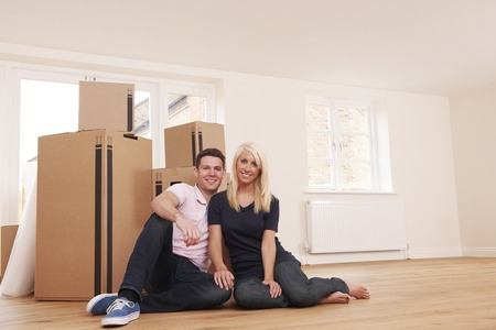 property ladder: Couple Moving Into New Home Together