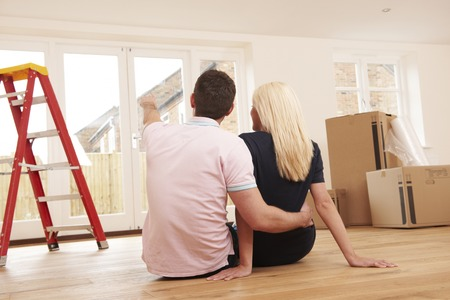 property ladder: Young Couple Making Plans For New Home