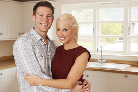 first home: Young Couple In First Home Together Stock Photo