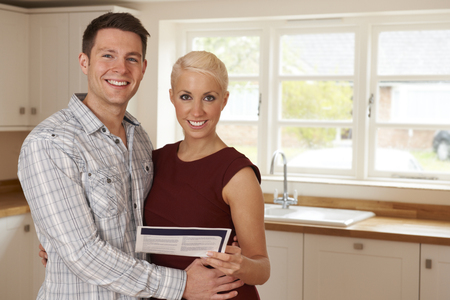 couple home: Young Couple Looking At Details For New Home