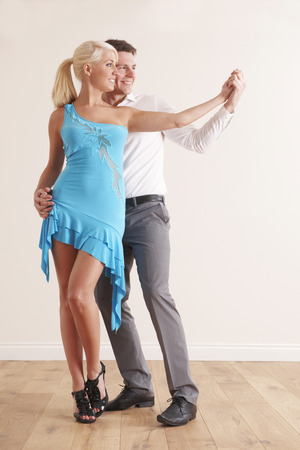 tangoing: Young Couple Dancing Together