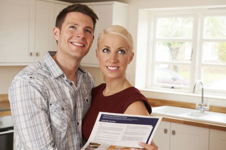 property ladder: Young Couple Looking At Details For New Home