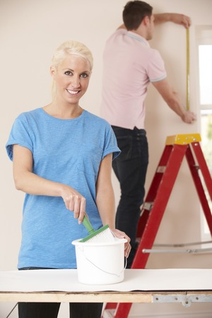 home decorating: Young Couple Decorating Home Together