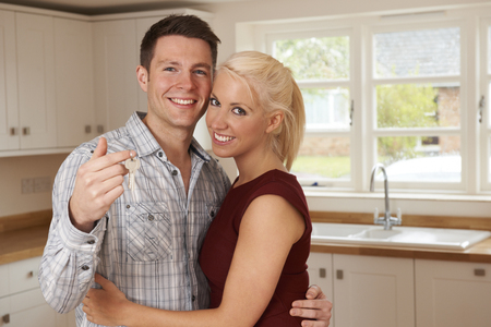 couple home: Young Couple With Keys To New Home Stock Photo