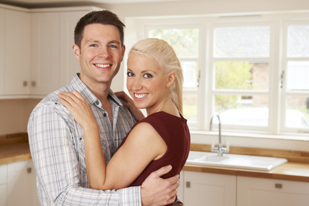 property ladder: Young Couple In New Home Together Stock Photo