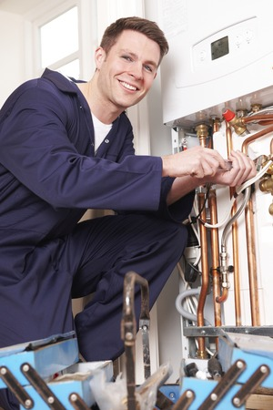 Engineer Servicing Central Heating Boiler