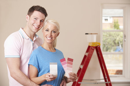 property ladder: Couple Looking At Paint Swatches Together