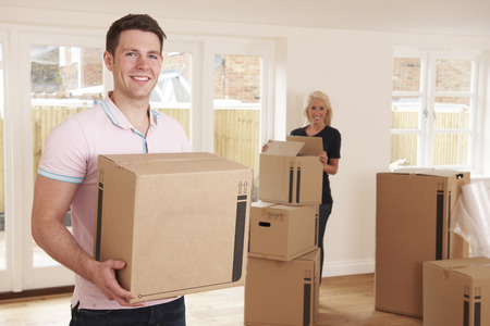 property ladder: Young Couple Moving Into New Home