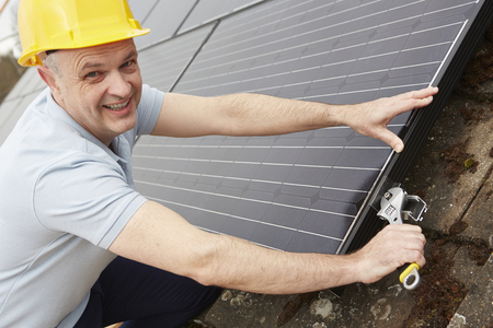 adjustable wrench: Engineer Installing Solar Panels On Roof Of House