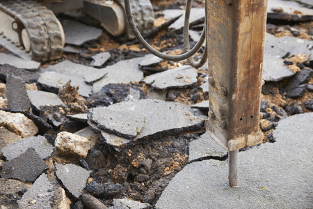 breaking up: Close Up Of Jackhammer Breaking Up Road Surface