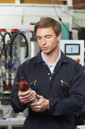 computerised: Engineer Checking Component In Factory