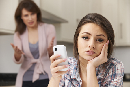 girl home: Mother Arguing With Daughter Over Use Of mobile Phone