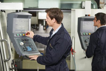 computerized: Engineer Operating Computerized Cutting Machine Stock Photo