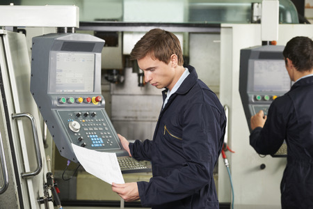 operator: Engineer Operating Computerized Cutting Machine Stock Photo