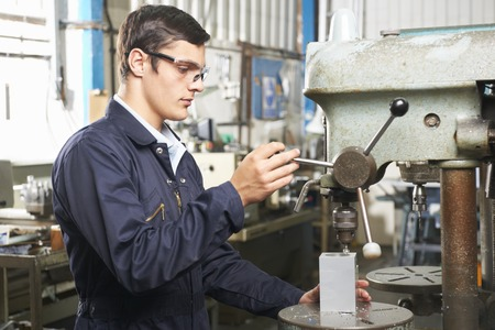 operate: Teenage Apprentice Operating Drill In Factory