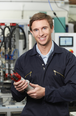 computerised: Engineer Holding Component In Factory