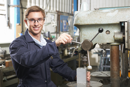 machinist: Engineer Using Drill In Factory Workshop Stock Photo