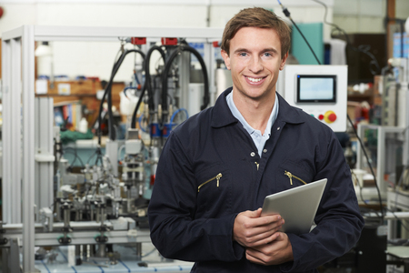 Engineer In Factory Holding Digital Tablet Stock Photo