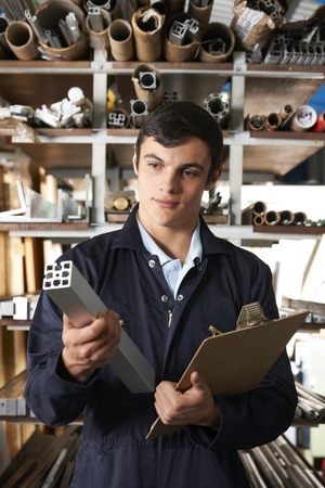 componentes: Factory Worker In Store Room With Components