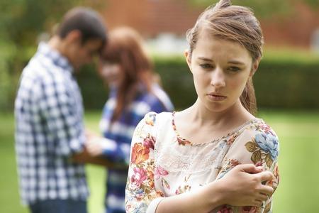 teenager girl: Lonely Teenage Girl Jealous Of Couple In Background