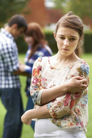 rejection sad: Lonely Teenage Girl Jealous Of Couple In Background